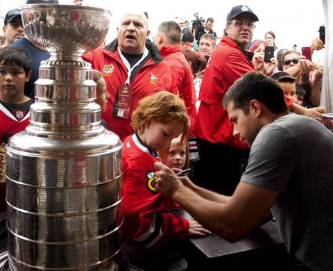 Chateauguay native and Chicago Blackhawks goalie Corey Crawford greets fans and signs autographs as he visits his former hometown in Montreal on Monday, Sept. 2.