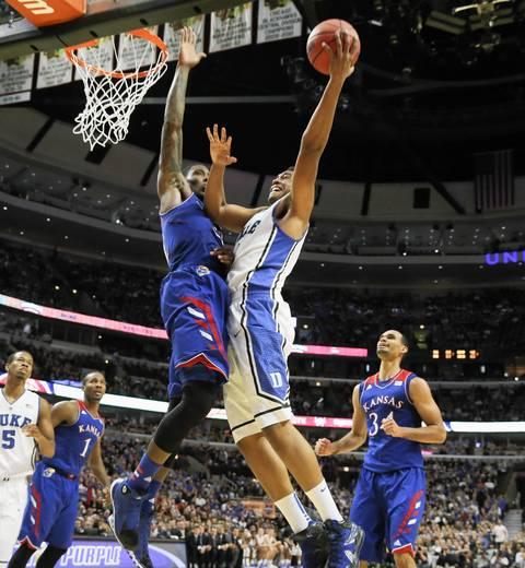 Duke forward Jabari Parker shoots over Kansas forward Jamari Traylor.
