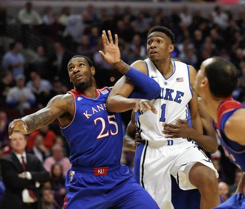 Duke forward Jabari Parker battles for a rebound with Kansas forward Tarik Black.