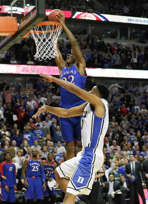 Kansas guard Andrew Wiggins is fouled by Duke forward Jabari Parker.