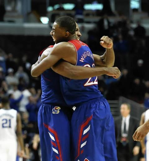 Kansas guard Wayne Selden Jr., hugs teammate Andrew Wiggins after their teams' win.