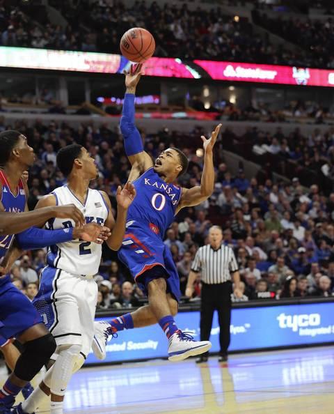 Kansas' Frank Mason releases an off-balance shot.