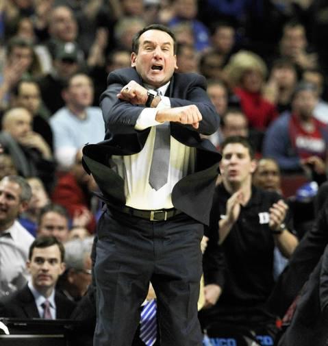 Duke coach Mike Krzyzewski signals instructions to his team.