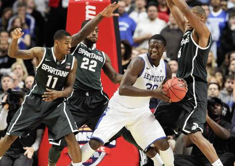 Kentucky forward Julius Randle is surrounded by Michigan State's Keith Appling (11), Branden Dawson (22) and Adreian Payne.
