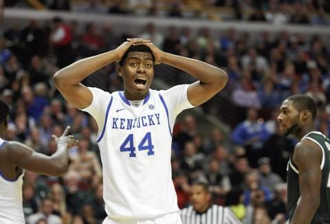 Kentucky center Dakari Johnson reacts after an official's call.