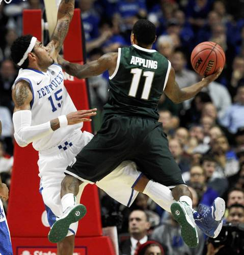 Michigan State guard Keith Appling soars to the basket against Kentucky forward Willie Cauley-Stein.