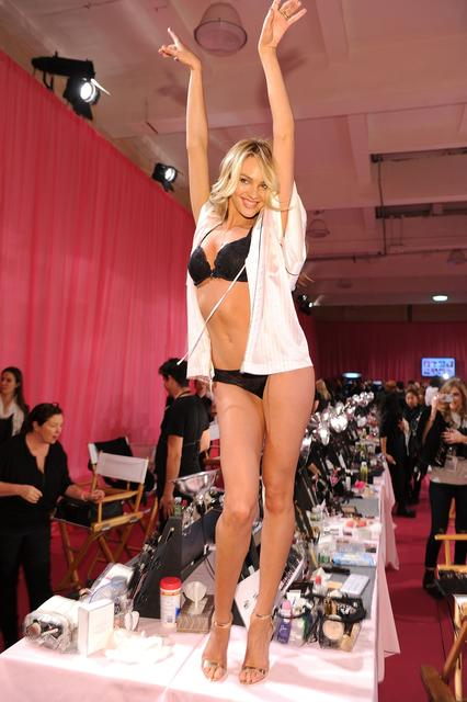 Model Candice Swanepoel poses at the 2013 Victoria's Secret Fashion Show hair and make-up room at Lexington Avenue Armory on November 13, 2013 in New York City.
