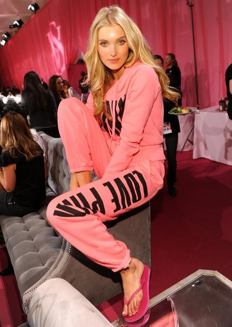 Model Elsa Hosk prepares at the 2013 Victoria's Secret Fashion Show hair and make-up room at Lexington Avenue Armory on November 13, 2013 in New York City.