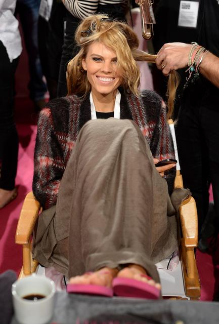 Model Maryna Linchuk prepares at the 2013 Victoria's Secret Fashion Show hair and make-up room at Lexington Avenue Armory on November 13, 2013 in New York City.