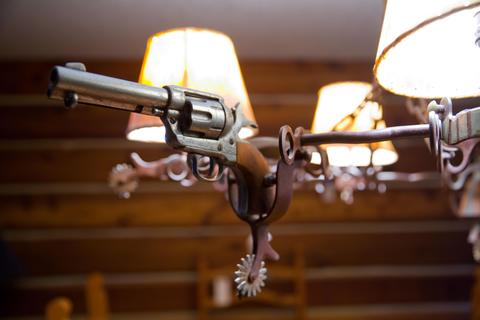 A chandelier made of guns and spurs adorns Rita Crundwell's personal home in Dixon. Her possessions are being auctioned and her home will be sold in a forfeiture sale.