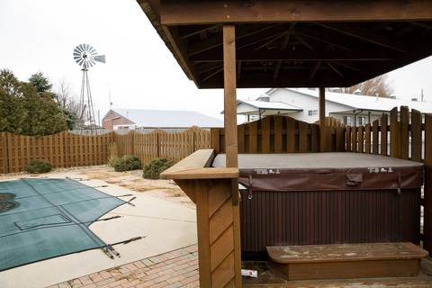 A swimming pool and a hot tub at going up for sale at Rita Crundwell's personal home in Dixon, Ill.