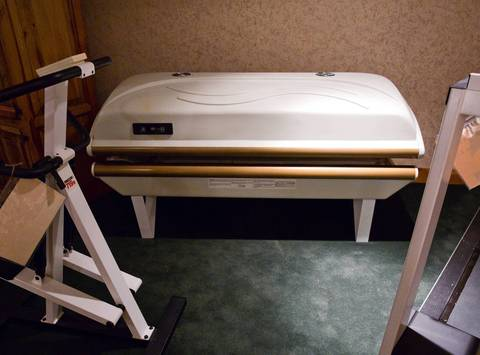 A tanning bed at Rita Crundwell's home will be sold at auction.
