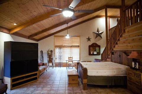 A 5-foot wide television and a bed are part of the master bedroom area of Rita Crundwell's personal home in Dixon. Her possessions are being auctioned and her home will be sold in a forfeiture sale.
