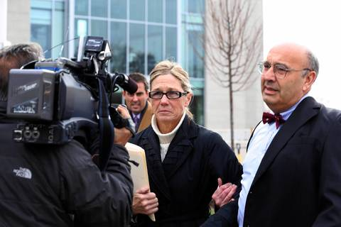 Rita Crundwell, former comptroller for the City of Dixon, is lead away by her attorney, Paul Gaziano, following Crundwell pleading guilty today in Federal Court in Rockford. Crundwell stole $53 million dollars in funds.