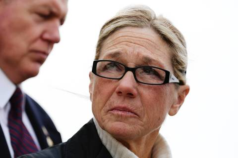 Rita Crundwell, former comptroller for the City of Dixon, turns away as her attorney briefly speaks with reporters after Crundwell pleaded guilty of fraud in federal court in Rockford, for stealing $53 million from the coffers of the small northwestern Illinois city over two decades. Crundwell will remain free on her own recognizance until her sentencing on Feb. 14.