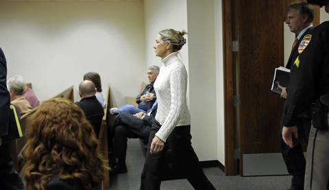 Former Dixon comptroller Rita Crundwell walks into Judge Ronald Jacobson's courtroom at the Lee County Courthouse in Dixon, Ill., for her arraignment on felony theft charges