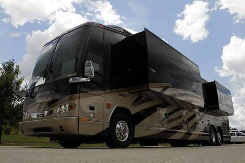 """Rita Crundwell's motor home sits in the parking lot of the Oak Creek Police Department in Oak Creek, Wisconsin. The motor home owned by Crundwell, accused of stealing $53 million from the city, was decked out with """"no expense spared."""""""