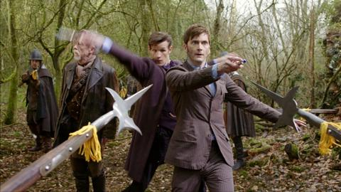 The 10th Doctor (David Tennant, right), the 11th Doctor (Matt Smith, center) and the mystery Doctor (John Hurt) are surrounded.