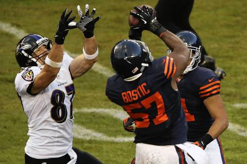 Chicago Bears inside linebacker Jon Bostic (57) grabs a interception on a pass meant for Baltimore Ravens tight end Dallas Clark (87) in the second quarter at Soldier Field.