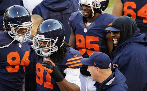 Chicago Bears defensive end David Bass (91) celebrates with his teammates after scoring a touchdown in the second quarter against the Baltimore Ravens.
