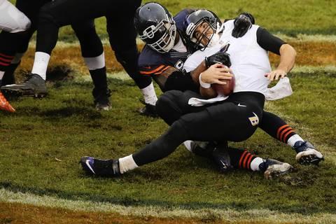 Chicago Bears defensive end Julius Peppers (90) sacks Baltimore Ravens quarterback Joe Flacco (5) in the second quarter.