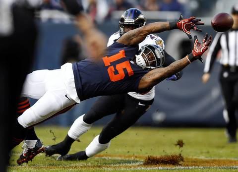 Chicago Bears' Brandon Marshall slips while missing a pass from Josh McCown in 1st quarter against Baltimore Ravens.
