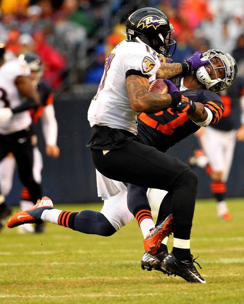 Bears defensive back Sherrick McManis tries to take down Ravens wide receiver Tandon Doss during the first quarter.