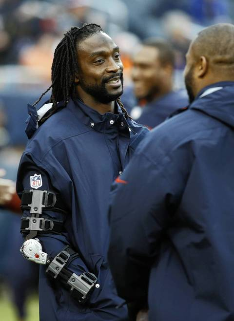 Injured Chicago Bears cornerback Charles Tillman talks with injured outside linebacker Lance Briggs before the Bears take on the Baltimore Ravens at Soldier Field.