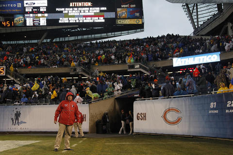 Fans are evacuated from the stadium due to a severe storm.