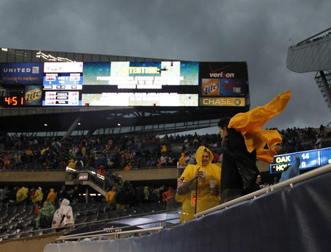 Fans are evacuated from the stadium due to a severe storm which stopped the Bears game.
