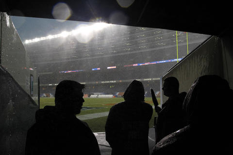 Stadium security watch from the south west tunnel as a severe storm hits Soldier Field.