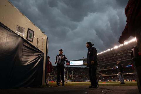 An official leaves the field during a suspension of play in the 1st quarter.