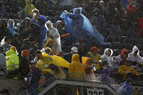 Bears fans evacuate the stadium bowl during a suspension of play.