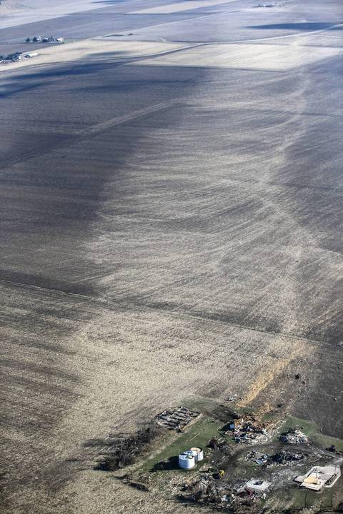 The circular pattern of the tornado can be seen in fields near Washington, Ill.