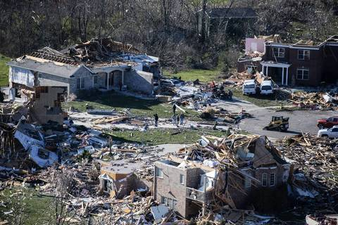 Houses with their roofs ripped off at the end of a cul-de-sac in Washington, Ill.