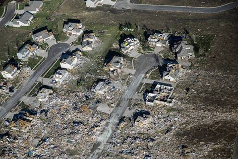 Houses that had their roofs removed by the tornado in Washington, Ill.