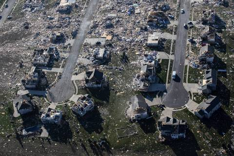 Destroyed houses on adjacent cul-de-sacs in Washington, Ill.