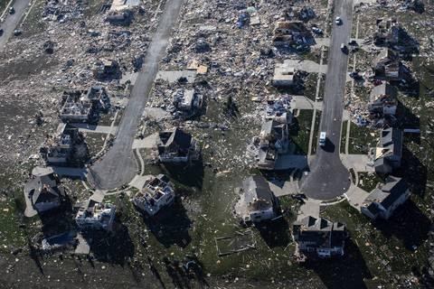 Destroyed houses on adjacent cul-de-sacs in Washington, Ill.