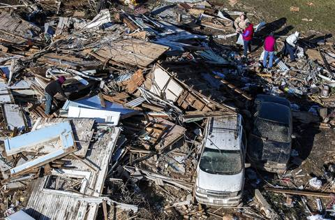 People search through the debris from the tornado in Washington, Ill.