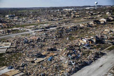 The water tower in Washington, Ill., is still standing near the path of the tornado.