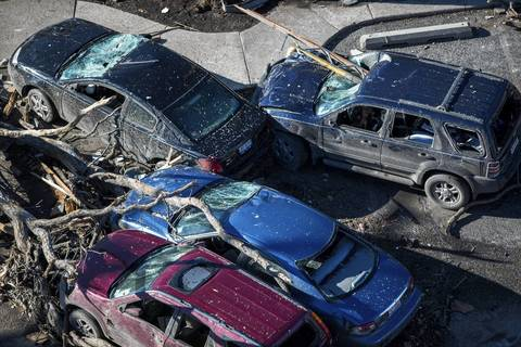 Destroyed cars, including one impaled through the windshield, in Washington, Ill.