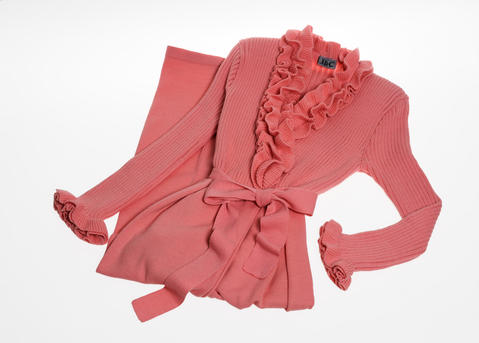 This bubblegum pink robe with ruffled collar and wrist cuffs is ladylike and luxurious. $253 at Linens and Lingerie