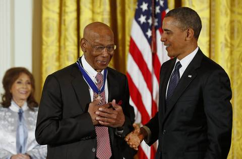 Baseball Hall of Fame player Ernie Banks reacts after receiving the Presidential Medal of Freedom from U.S. President Barack Obama, right, at a ceremony in the East Room of the White House in Washington, D.C.