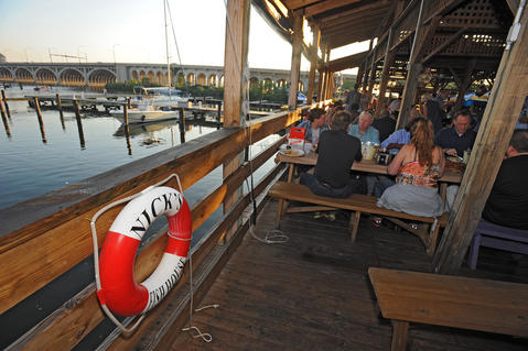 Live music on the deck, solid bar food and free dockage - what more could a sailor need?  Nick's Fish House & Grill, 2600 Insulator Drive, Port Covington, 410-347-4123, nicksfishhouse.com