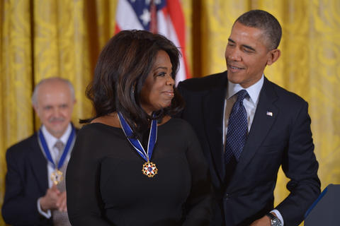 US President Barack Obama presents the Presidential Medal of Freedom to broadcast journalist Oprah Winfrey during a ceremony in the East Room of the White House in Washington, DC.