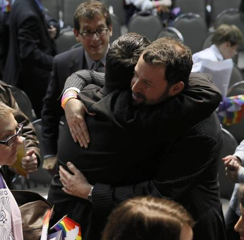 People celebrate after Illinois Gov. Pat Quinn signs the gay marriage bill at the UIC Forum.