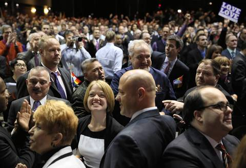 People in the crowd at the UIC Form react after Illinois Gov. Pat Quinn signed the gay marriage bill, making Illinois the 16th state to legalize same-sex marriage.