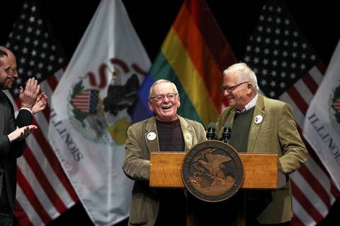 Longtime couple Jim Darby and Patrick Bova have a laugh as they speak prior to Illinois Gov. Pat Quinn signing into law the gay marriage bill.