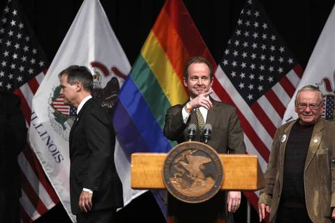 Chicago Alderman Tom Tunney (44th) takes the stage before Illinois Gov. Pat Quinn signs the gay marriage bill into law at the UIC Forum. The law makes Illinois the 16th state to legalize gay marriage.