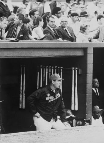 Richard Nixon can be seen above the Washington Senators' dugout in this photograph of Ted Williams.